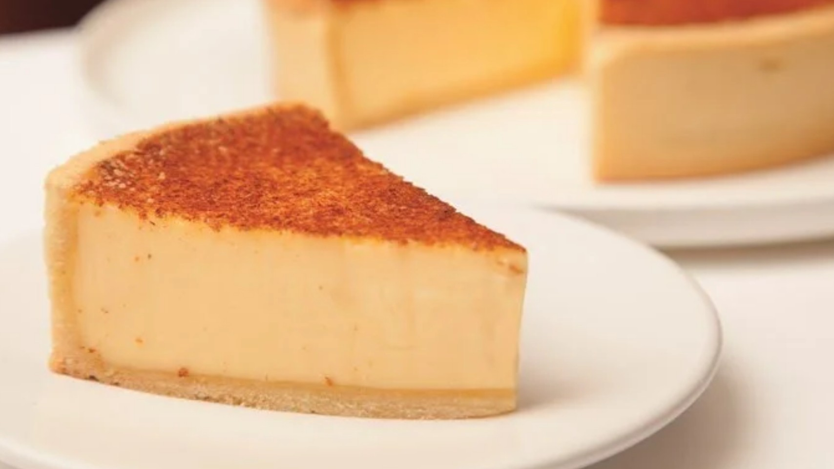 A piece of Custard Tart on a white plate by Marcus Wareing, awarded as Remy Martin Best Dessert in 2012