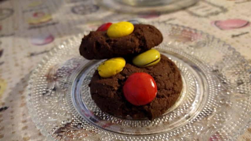 Two candy cookies on a small plate
