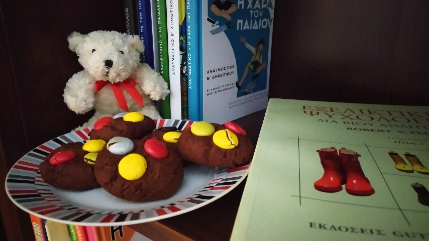 Rupert, a plate with cookies and books on a bookcase shelf