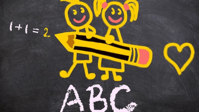 Sketch on a blackboard showing two children holding a giant pencil and writing 1+1=2. Underneath there is written A, B, C and on the side there is a heart sketch